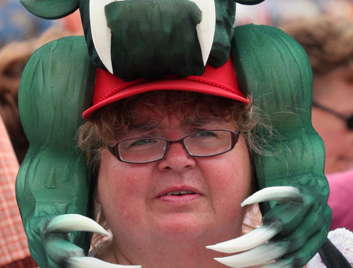 Kay Recker of Milwaukee, wears a Hodag cheesehat at Hodag Country Festival near Rhinelander, Saturday, July 8, 2011.