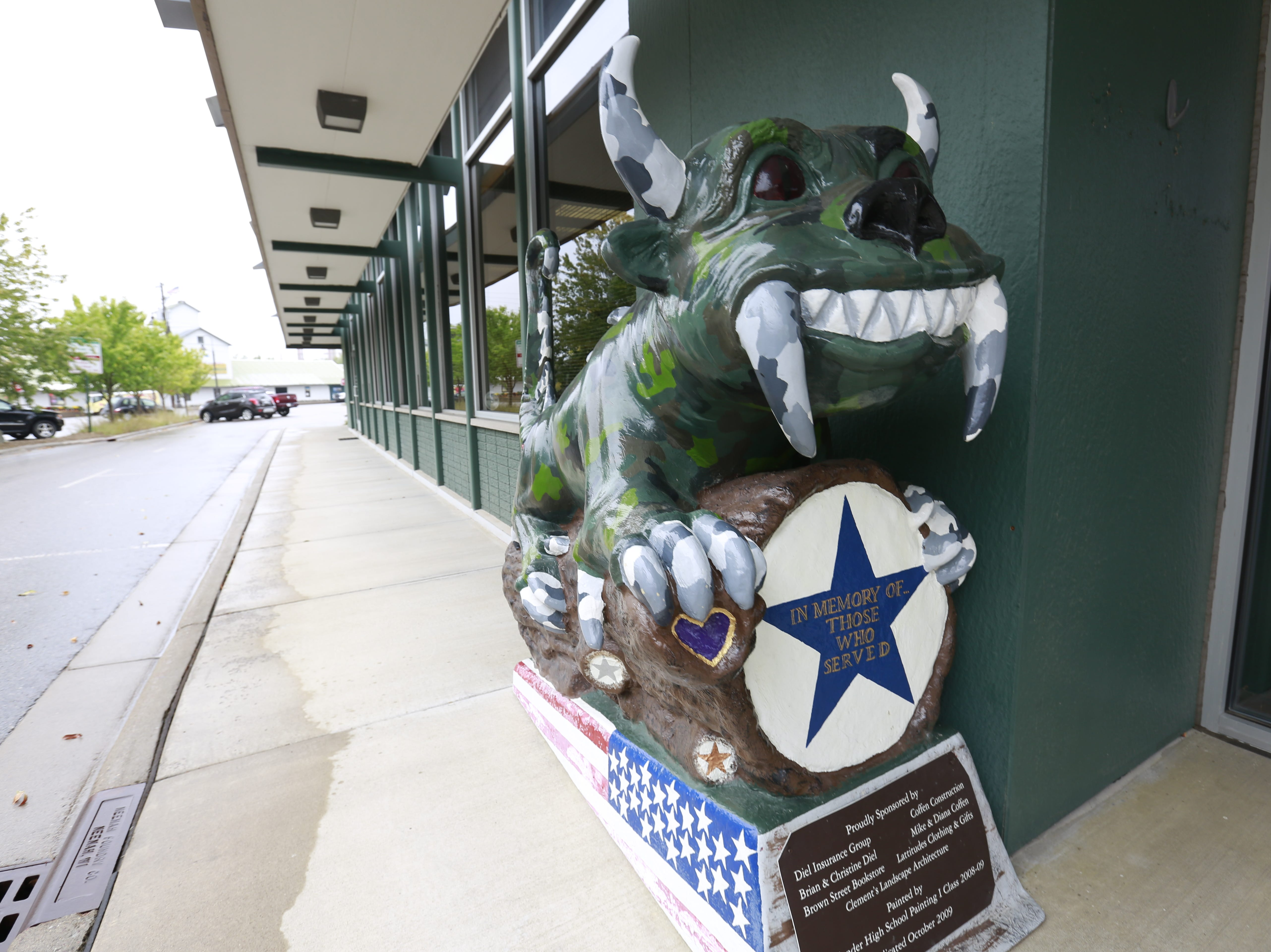 A Hodag sculpture sits Tuesday, Sept. 25, 2018, at Diel Insurance Group in Rhinelander, Wis.