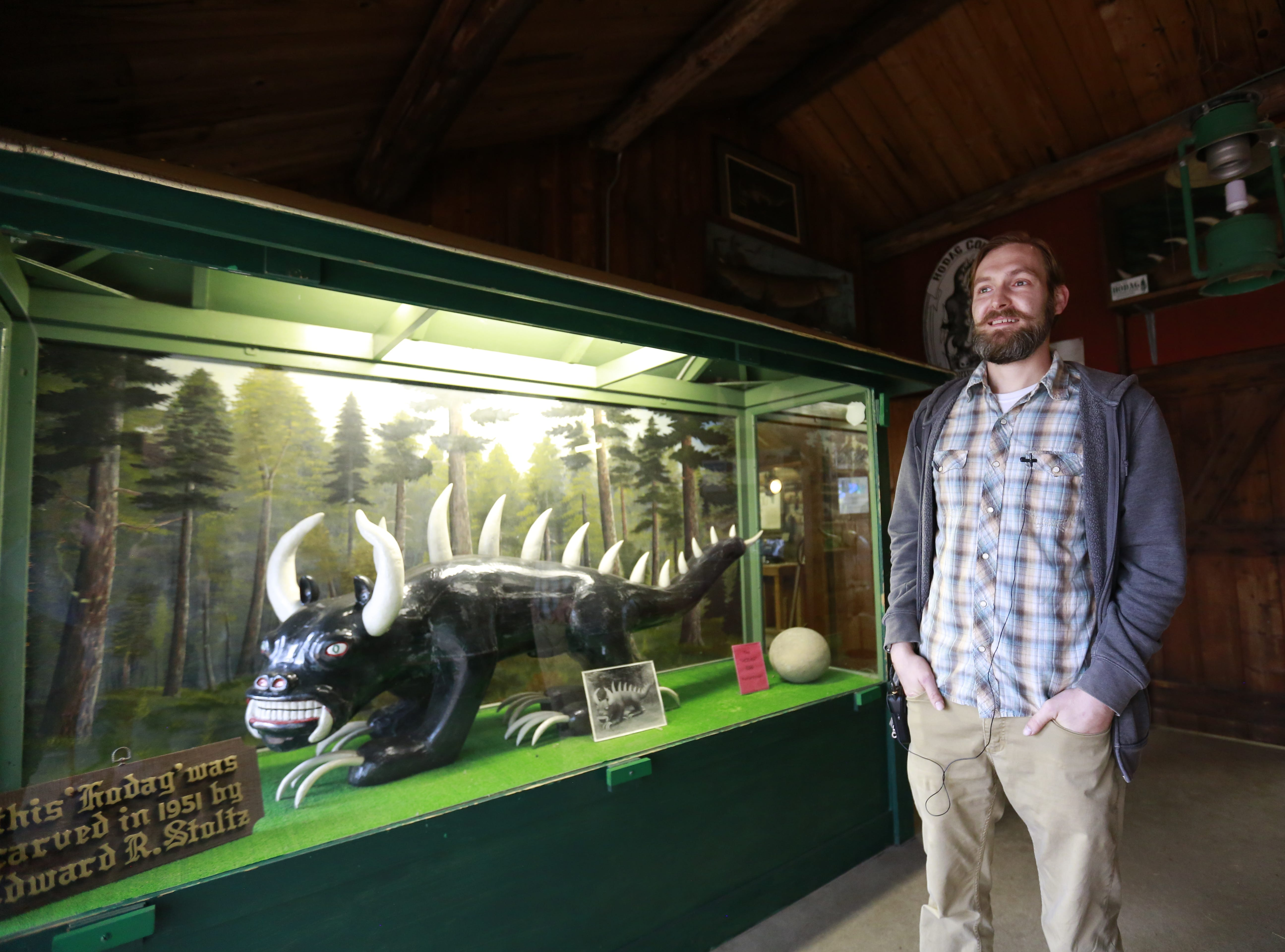 Coordinator Kerry Bloedorn retells the history behind the mythical creature Hodag to USA TODAY NETWORK-Wisconsin's reporter Keith Uhlig Tuesday, Sept. 25, 2018, at Pioneer Park Historical Complex in Rhinelander, Wis.