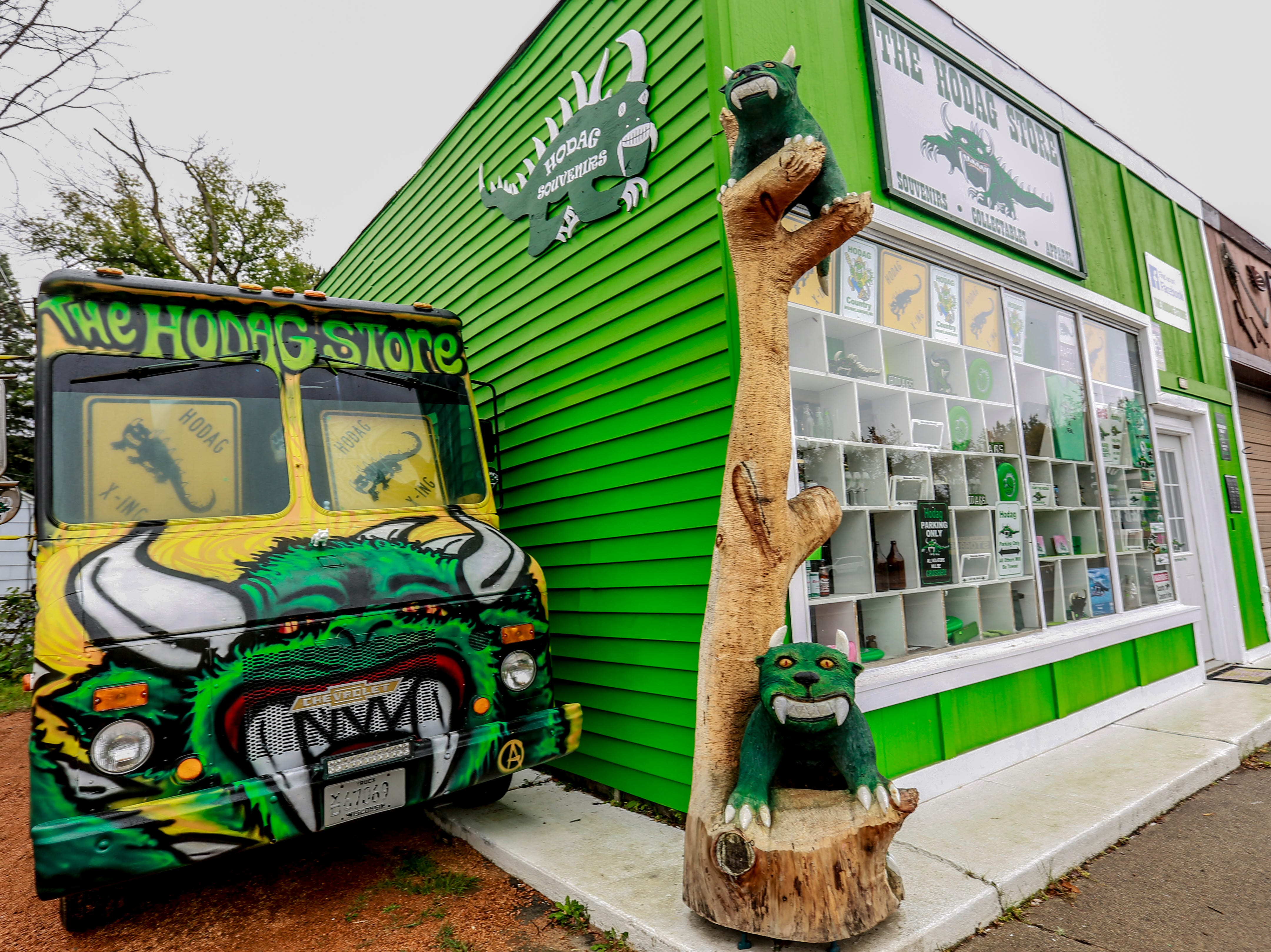 Hodag creature sculptures and images display Tuesday, Sept. 25, 2018, at The Hodag Store in Rhinelander, Wis.
