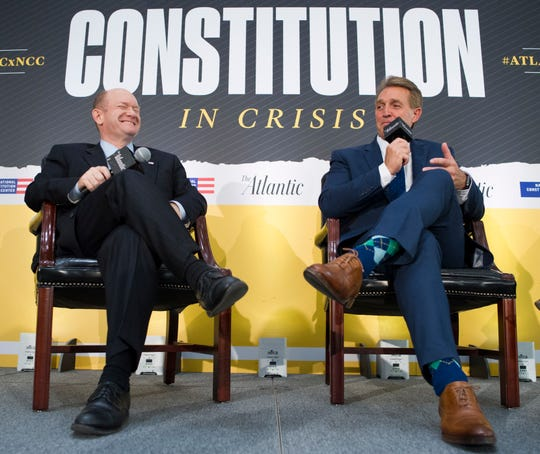 "Sen. Chris Coons, D-Del., and Sen. Jeff Flake, R-Ariz., and  participate in an interview at the The Atlantic's ""The Constitution in Crisis"" forum in Washington, on Tuesday, Oct. 2, 2018."