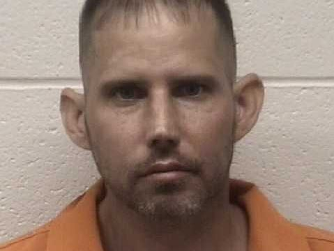 James Gilmer Adkins, 39, was arrested and charged by Elkton police with 16 counts on drug distribution and firearm possession.