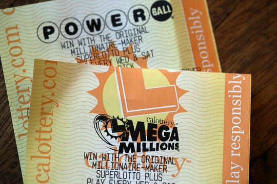 Powerball and Mega Millions lottery tickets are displayed on Jan. 3, 2018, in San Anselmo,  Calif.