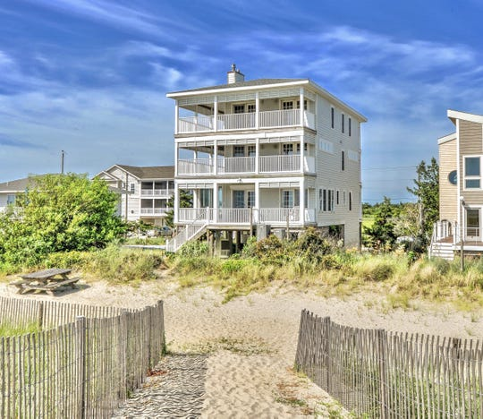 Decks on every level at 1416 S Bay Shore Drive at Broadkill Beach provide views of the water.