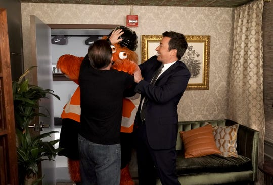 "Ricky Gervais, Philadelphia Flyers mascot Gritty and Jimmy Fallon during the cold open of ""The Tonight Show Starring Jimmy Fallon"" on Sept. 27."