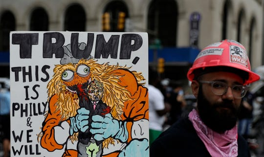 A demonstrator outside the Philadelphia Convention Center during a speech by President Trump, Tuesday, Oct. 2, 2018, in Philadelphia.
