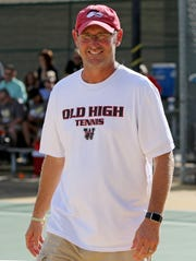 Wichita Falls High School head tennis coach Rob Woodard walks off the court after talking to his players during team tennis matches agianst Rider Tuesday, Oct. 2, 2018, at Rider.  The winningest girls soccer coach in the school's history, Woodard showed himself to be a team player by taking over team tennis this fall when the coach left just before the season. The Coyotes will be looking for a new coach this spring.