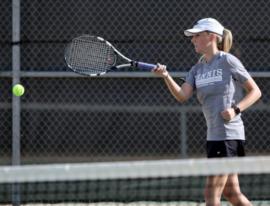 Wichita Falls High School's Lily Kaster hits from the baseline in a doubles match against Rider Tuesday, Oct. 2, 2018, at Rider.