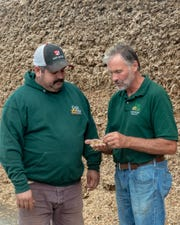 "Leopold Conservation award finalist David Geiser (right) talks with Manual ""Manny"" Valenzuela, who came to the farm as an employee in 2000 and who became an owning and managing partner at the start of 2015."