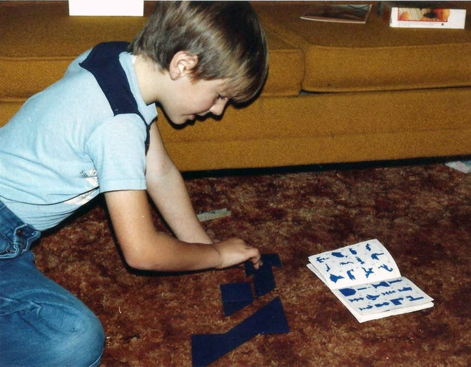 Eight-year-old Russell Manzke working a puzzle