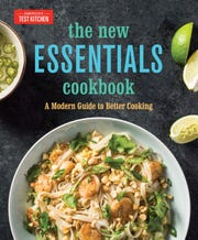 """This image provided by America's Test Kitchen in September 2018 shows the cover for the cookbook New Essentials."""" It includes a recipe for a Grown-Up Grilled Cheese with Cheddar and Shallot."""