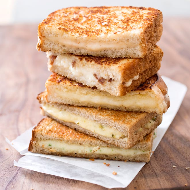This undated photo provided by America's Test Kitchen in September 2018 shows a Grown-Up Grilled Cheese with Cheddar and Shallot in Brookline, Mass. This recipe appears in the cookbook New Essentials.