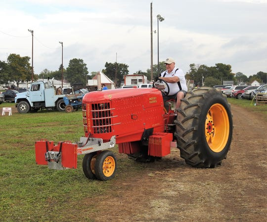 Ron Brokaw goes to weigh his tractor shortly before open class tractor pulls Tuesday at the Coshocton County Fair.