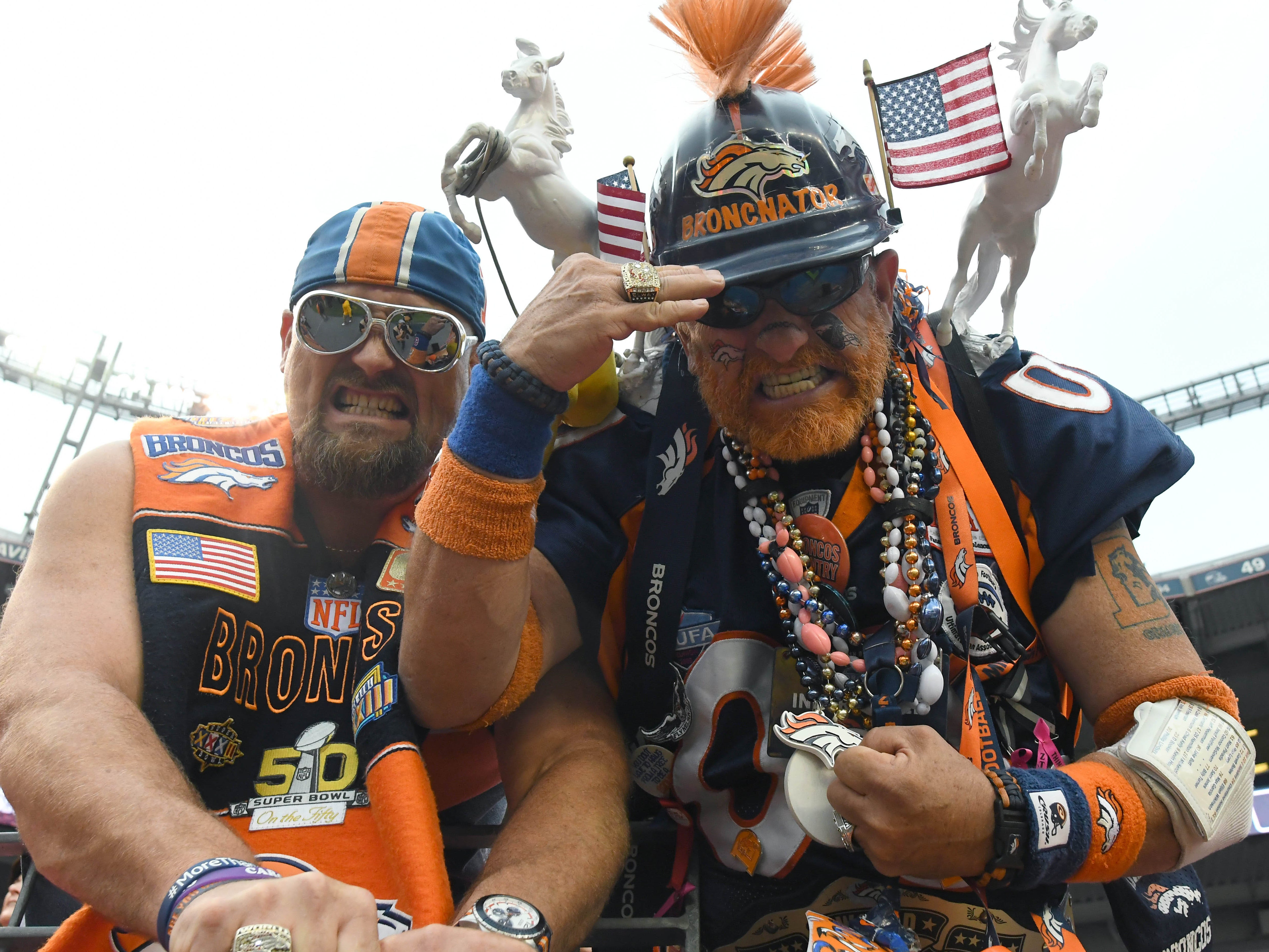 Denver Broncos fans react before the Monday night game against the Kansas City Chiefs at Broncos Stadium at Mile High.