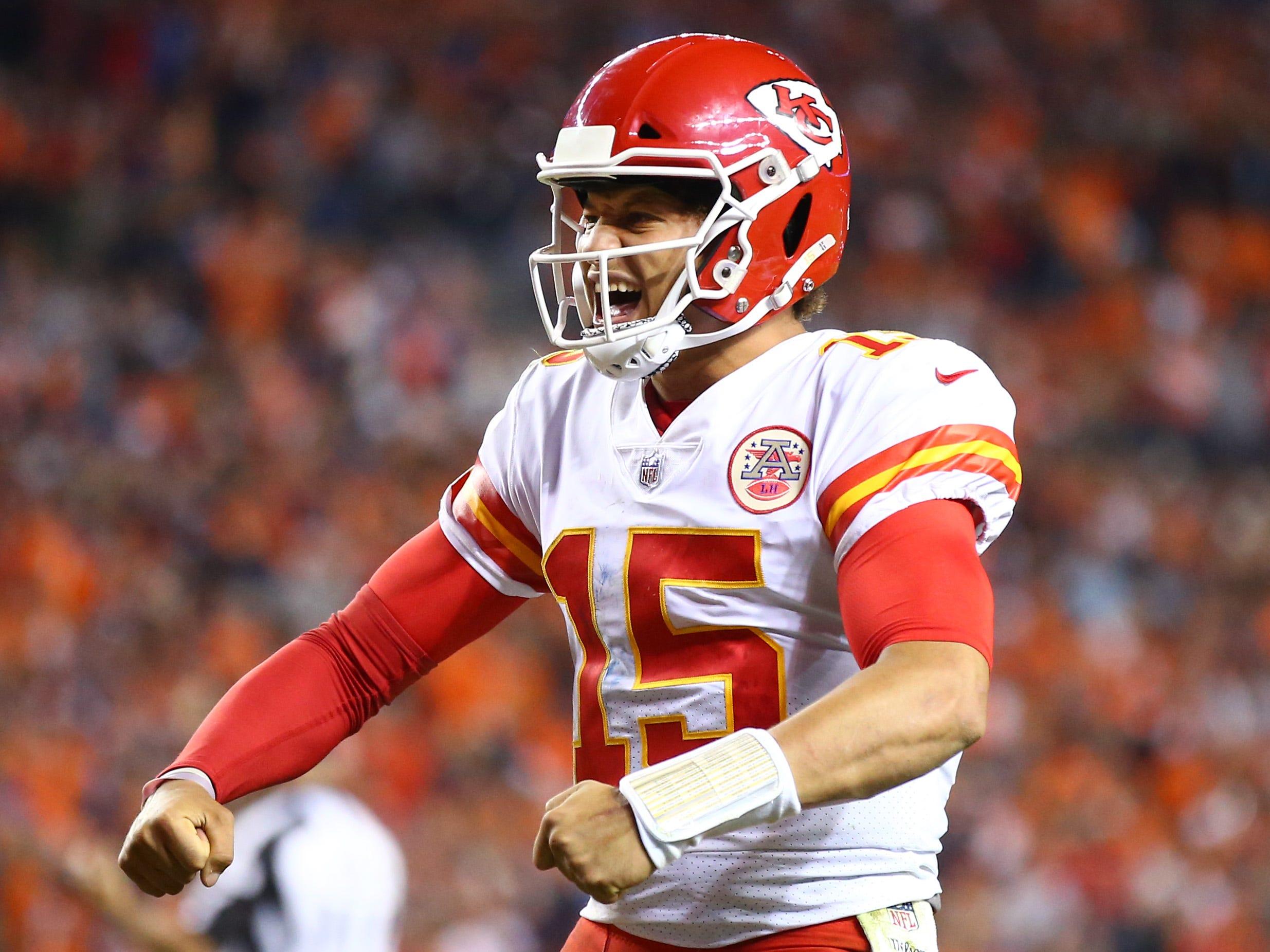 Kansas City Chiefs quarterback Patrick Mahomes celebrates Kareem Hunt's go-ahead touchdown in the fourth quarter  against the Denver Broncos.s