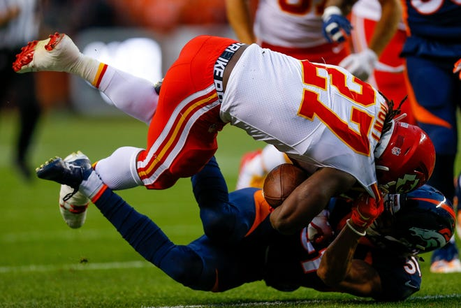 Chiefs RB Kareem Hunt takes on Broncos S Justin Simmons on Monday night.