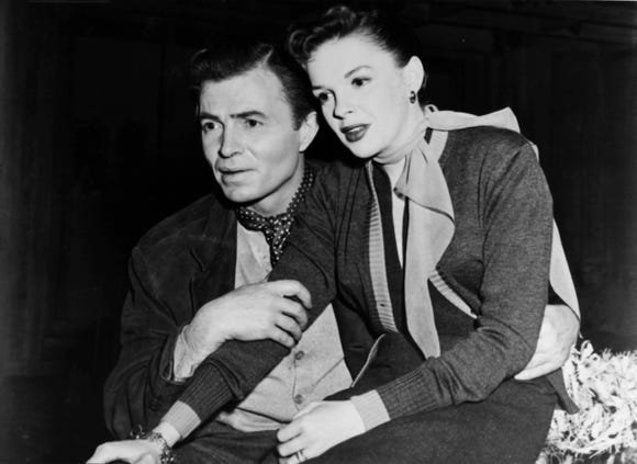 "Esther (Judy Garland) goes places with the help of famous actor Norman (James Mason) in 1954's ""A Star Is Born."""