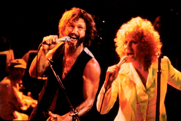 "John Norman (Kris Kristofferson) and Esther (Barbra Streisand) rock out in 1976's ""A Star Is Born."""