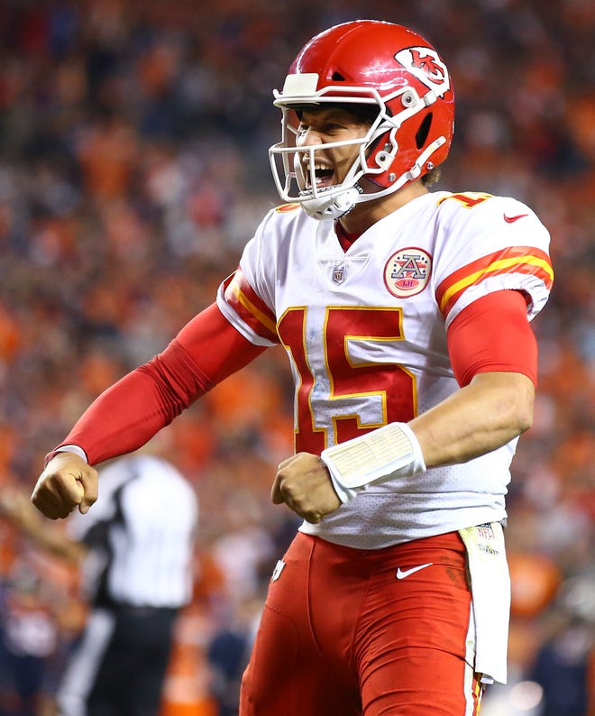 Patrick Mahomes celebrates Kareem Hunt's game-winning touchdown against the Broncos.