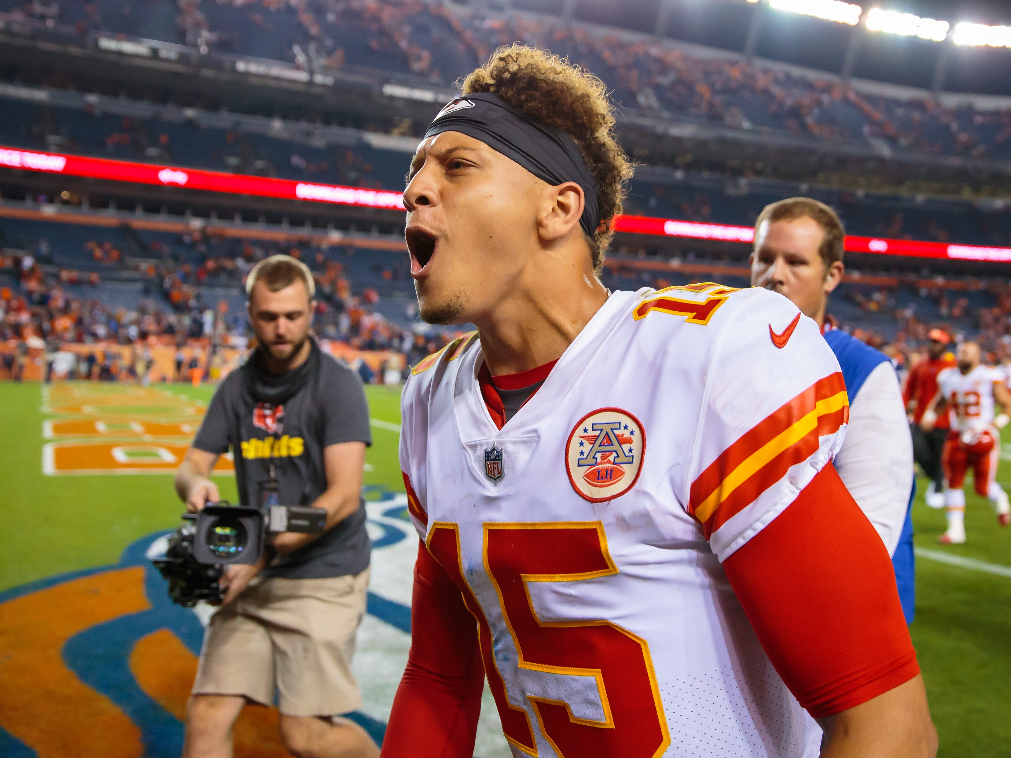 Kansas City Chiefs quarterback Patrick Mahomes celebrates as he leaves the field after defeating the Denver Broncos.