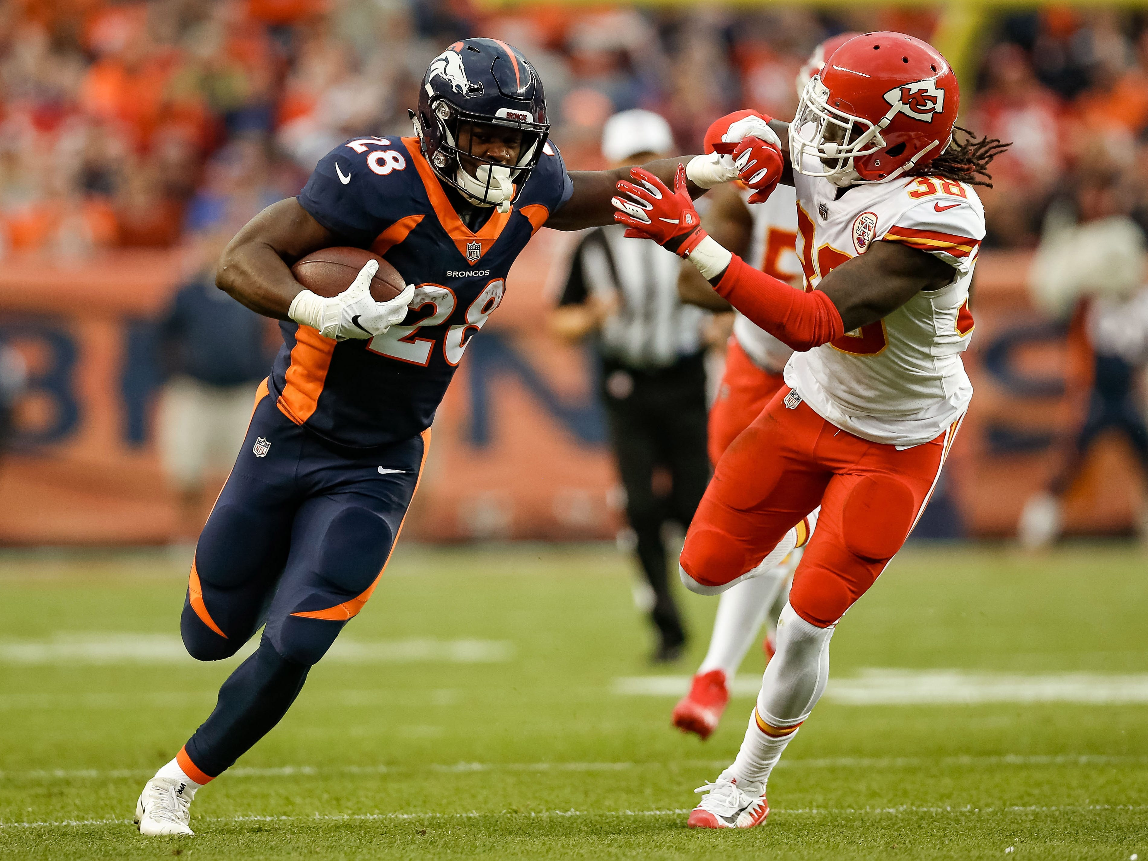 Denver Broncos running back Royce Freeman  runs the ball against the Kansas City Chiefs in the first quarter at Broncos Stadium at Mile High.