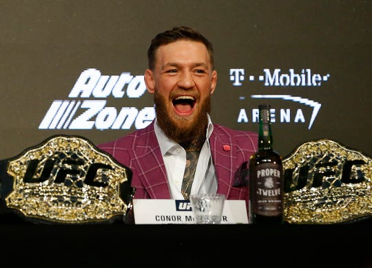 Conor McGregor's penchant for insult-filled barrages and over-the-top theatrics are either wildly entertaining or stomach-turning. Shown here, McGregor speaks at a news conference at Radio City Music Hall in New York.
