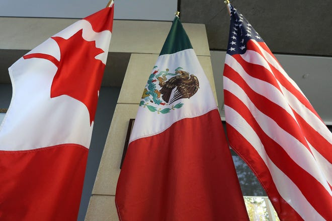 The Canadian, Mexican and United States flags.