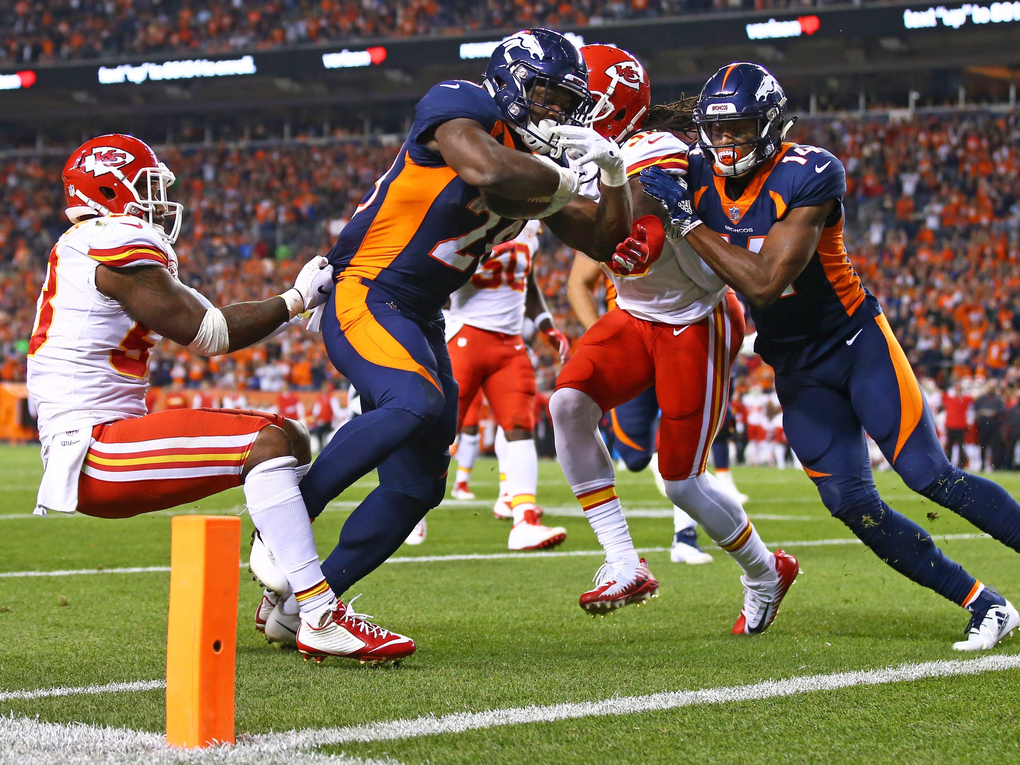 Denver Broncos running back Royce Freeman  scores a second quarter touchdown against the Kansas City Chiefs.