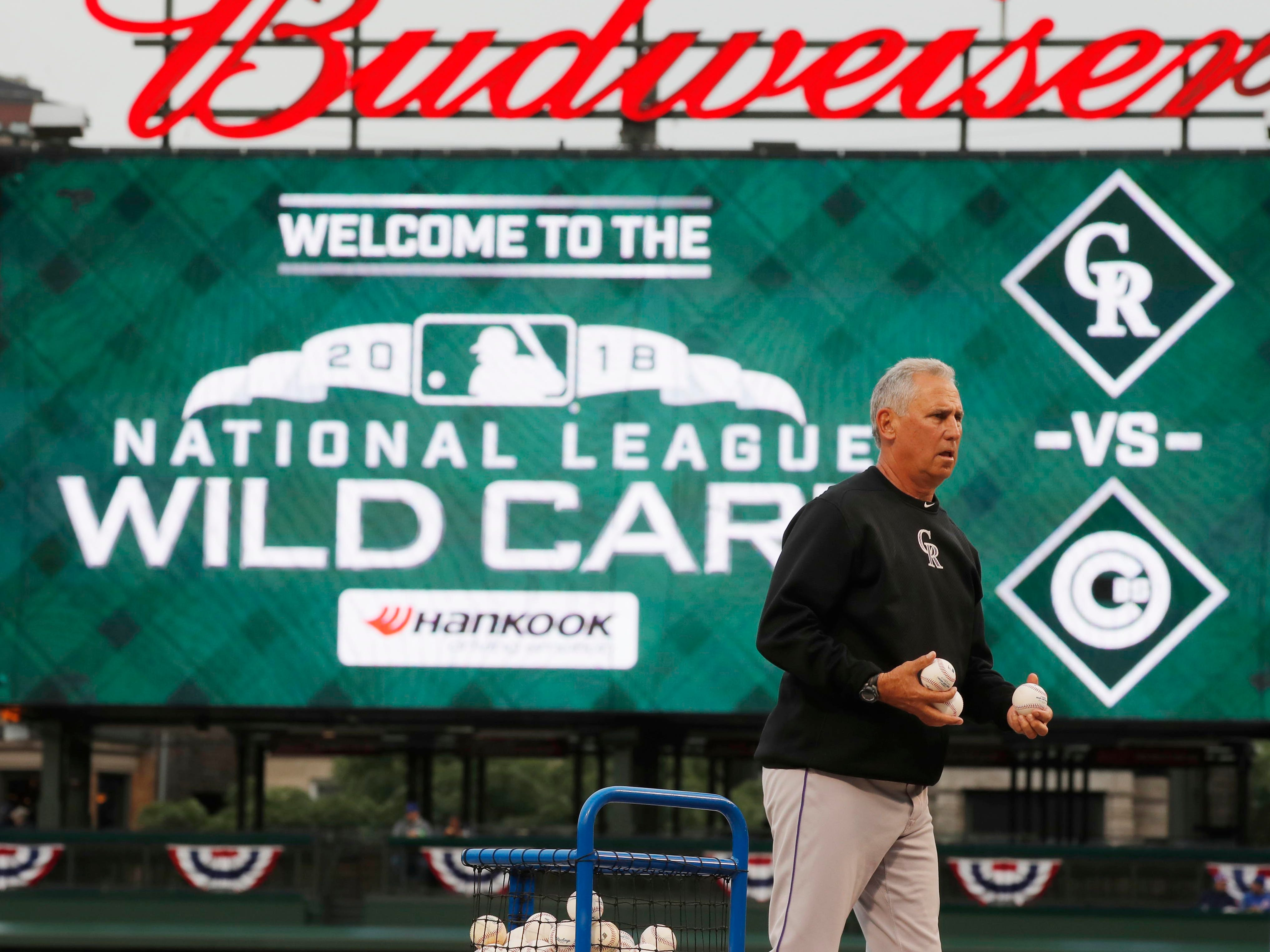 NL wild card: Rockies manager Bud Black tosses batting practice before the winner-take-all game.