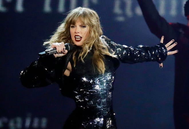"Taylor Swift, photographed performing in May, will open the ""2018 American Music Awards."""