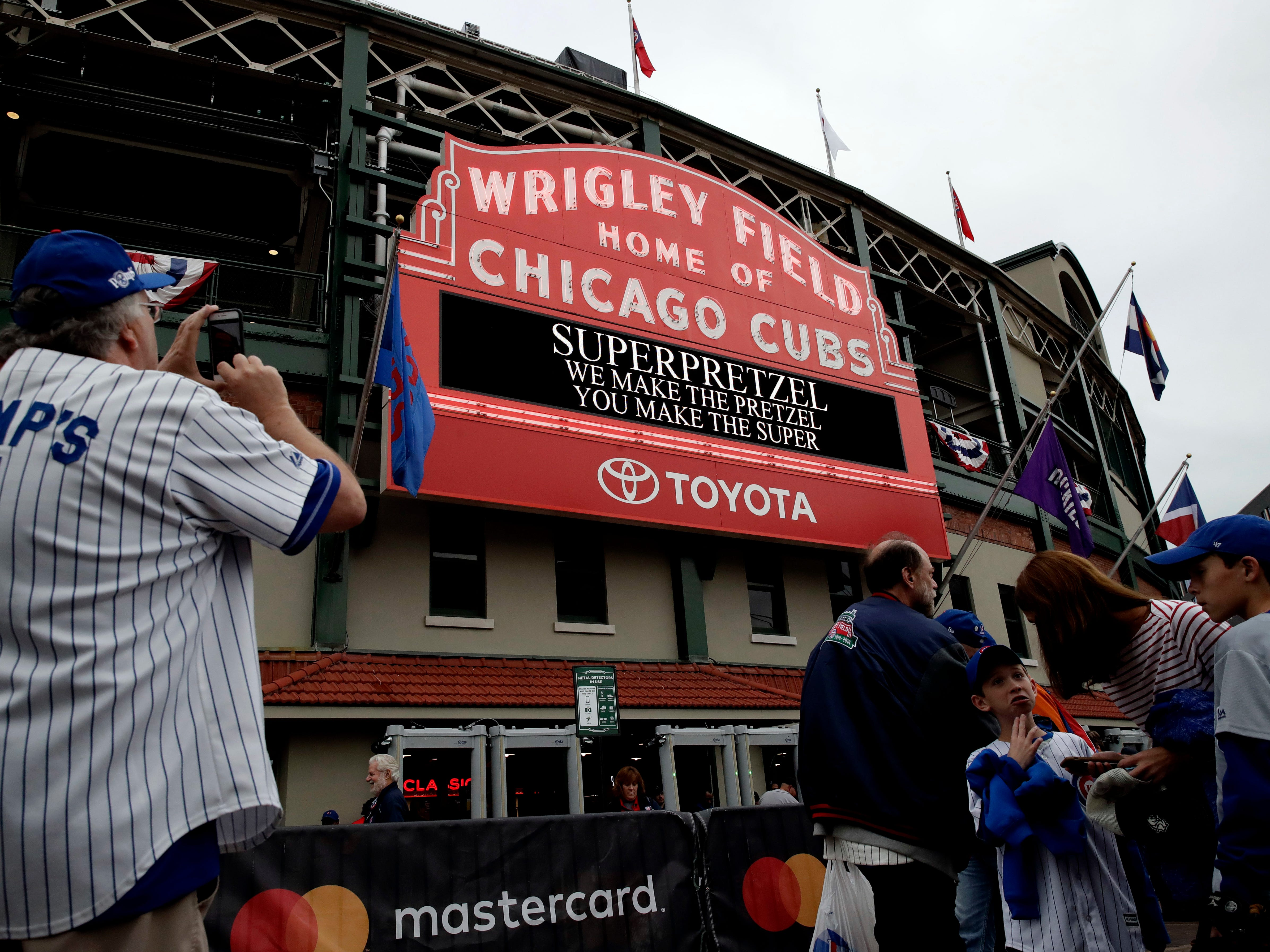 NL wild card: Cubs fans wait outside Wrigley Field before the game against the Rockies.