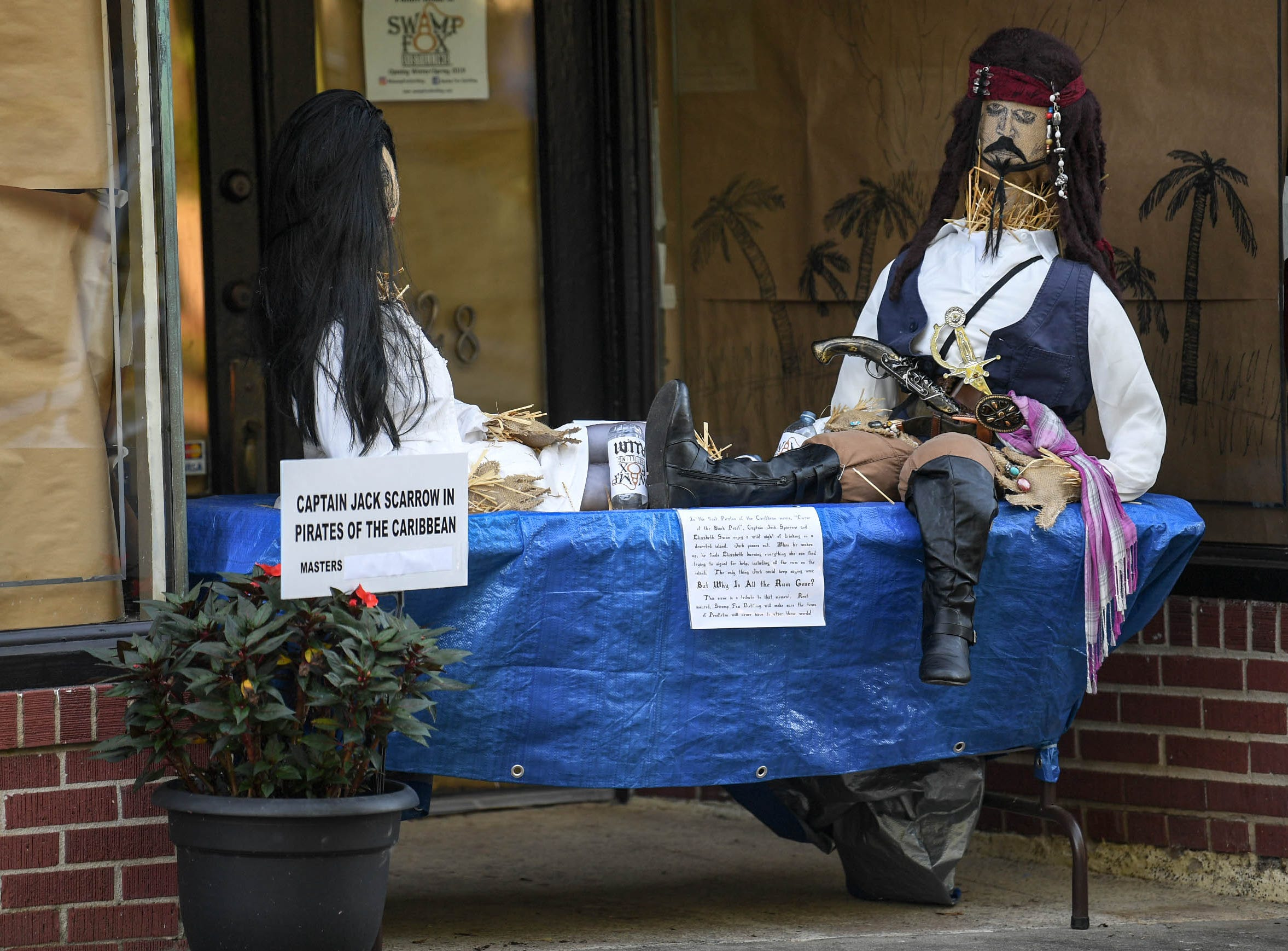 """Scarecrows on display, """"Captain Jack Scarrow in Pirates of the Caribbean,"""" in front of the Lazy Islander is one of many displays in The Pendleton Scarecrow Contest leading up to the 20th Fall Harvest Festival in the village green Saturday, October 6 from 10 a.m. to 5 p.m. The annual contest in Pendleton for businesses, individuals, groups, organizations and churches who create fun not scary Scarecrows. People driving around the downtown square can see different theme scarecrows."""