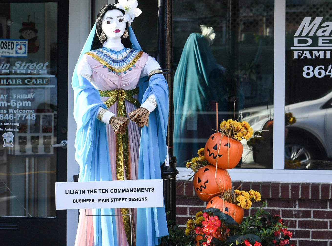 """""""Lilia In The Ten Commandments"""" by Main Street Designs, is one of many displays in The Pendleton Scarecrow Contest leading up to the 20th Fall Harvest Festival in the village green Saturday, October 6 from 10 a.m. to 5 p.m. The annual contest in Pendleton for businesses, individuals, groups, organizations and churches who create fun not scary Scarecrows. People driving around the downtown square can see different theme scarecrows."""