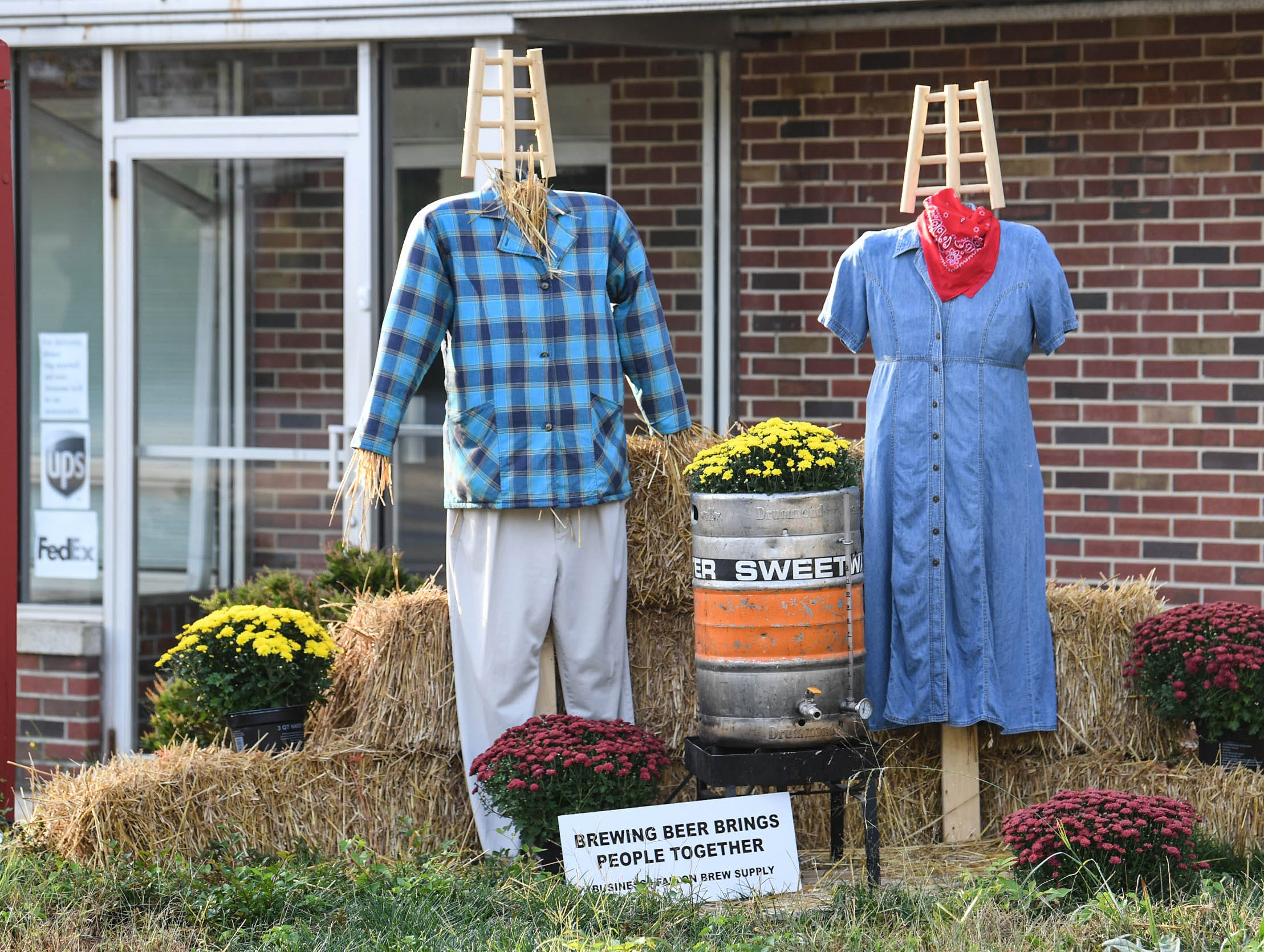 """""""Brewing Beer Brings People Together"""" is one of many displays in The Pendleton Scarecrow Contest leading up to the 20th Fall Harvest Festival in the village green Saturday, October 6 from 10 a.m. to 5 p.m. The annual contest in Pendleton for businesses, individuals, groups, organizations and churches who create fun not scary Scarecrows. People driving around the downtown square can see different theme scarecrows."""