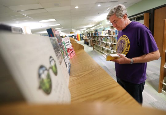 David Dodd of Appleton takes a look through the new non-fiction section of the Appleton Public Library.