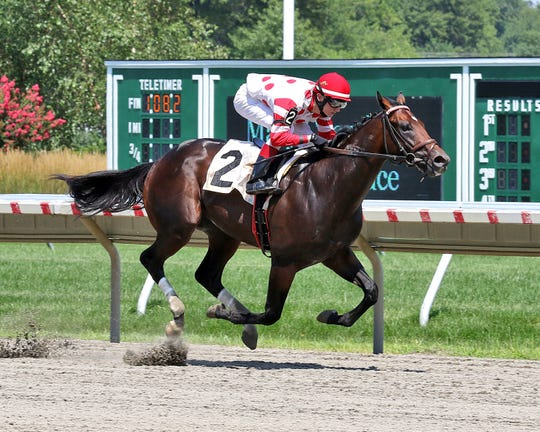 Mind Control, ridden by Trevor McCarthy, wins at Monmouth Park on Aug. 12.