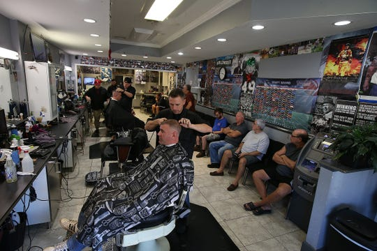 Justin Yahara, owner of Swagger Barbershop, a Middletown-based business, works on Chris Vaubel of Middletown in his barber chair at Swagger in Belford, NJ Friday, October 3, 2018.
