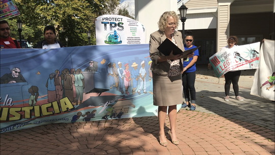Jo Smith Schloeder, district director for Congressman Chris Smith's Freehold office, reads a letter from the legislator about his support of the American Promise Act.