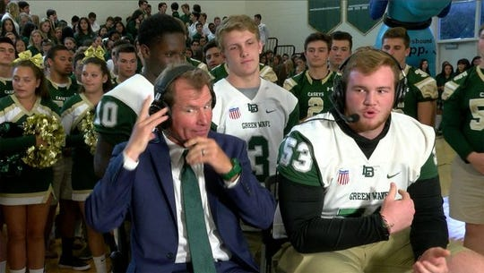 Long Branch coach Dan George and Green Wave lineman Kevin Cerruti and his teammaes Marc Dennis (No. 10) and Luke Arnold (No. 3) are shown during a taping of the USA TODAY NETWORK New Jersey Red Zone Road Show on Monday. Unbeaten Long Branch visits Unbeaten Red Bank Catholic Friday night.