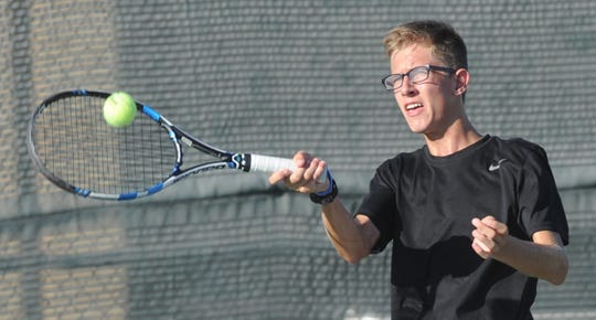 Abilene High's Brady Moore hits a return shot during his doubles match against Cooper's Ben Tollison and Parker Moore. Tollison and Parker Moore beat Brady Moore and Anthony Patino 7-6, 6-3, but Abilene High beat Cooper 11-8 in the non-district team tennis match Tuesday, Oct. 2, 2018, at the Cooper courts.