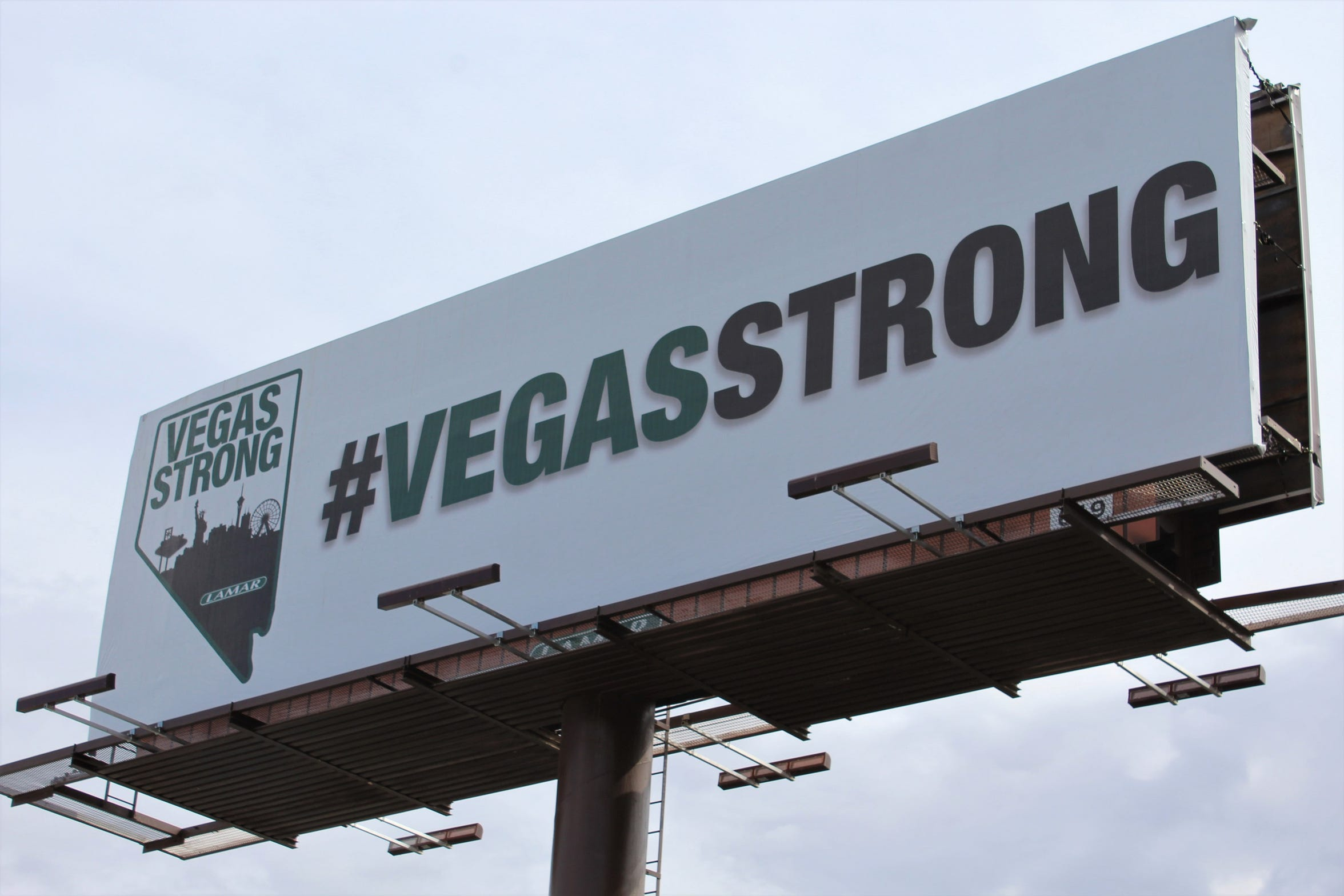 A billboard across the street from Mandalay Bay, where a man in a 32nd floor room shot at thousands attending an outdoor country music concert, killing 58.