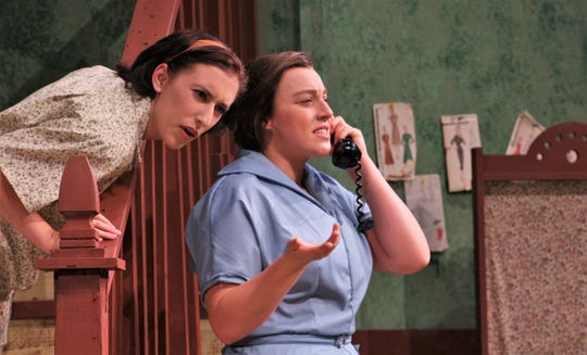 "Freda Benson (Cambria Jaramillo) talks on the phone while her 16-year-old daughter Jessie (Ashleigh Moss) listens in. McMurry University opens its 2018-19 theater season with the drama ""The Death and Life of Larry Benson."""