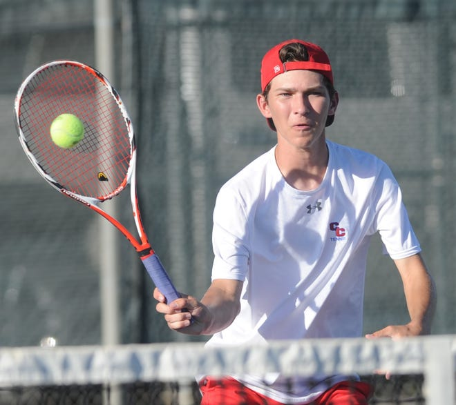 Cooper's Parker Moore hits a shot during his doubles match against Abilene High's Brady Moore and Anthony Patino. Parker Moore and Ben Tollison won the match 7-6, 6-3, but Abilene High beat Cooper 11-8 on Tuesday, Oct. 2, 2018, at the Cooper tennis courts.