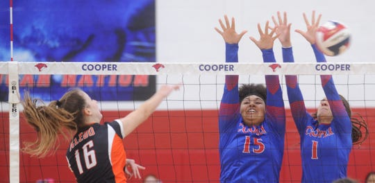 Cooper's Jada Willis (15) and Alexis Garcia (1) try to block a shot by Aledo's Lilly Taylor in Game 1. Aledo beat the Lady Cougars 25-20, 25-10, 25-21 in the District 4-5A volleyball match Tuesday, Oct. 2, 2018, at Cougar Gym.