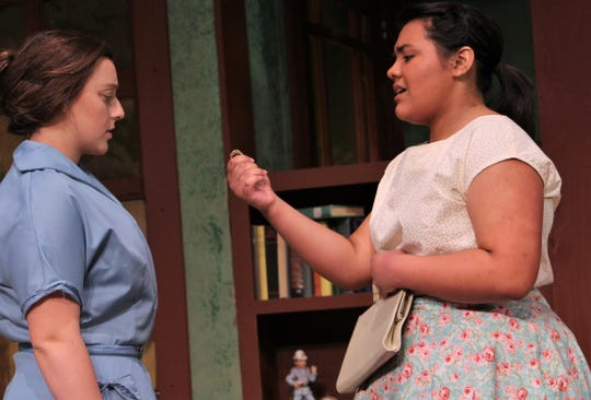 """On the eve of Larry Benson's return from the Korean War after being reported missing for three years, his girlfriend Grace (Victoria Picon) offers to return the class ring he gave her to his mother (Cambria Jaramillo, left) in this rehearsal scene from """"The Death and Life of Larry Benson."""" McMurry University opens the drama Thursday evening."""
