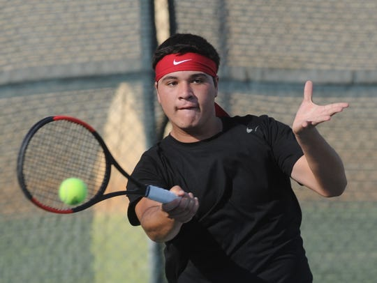 Abilene High's Elias Martinez returns a shot during his doubles match against Cooper's Aaron Hines and Michael Scarborough. Hines and Scarborough beat Martinez and Hunter Lee 6-3, 6-4, but Abilene High beat Cooper 11-8 during the non-district team tennis match Tuesday, Oct. 2, 2018, at the Cooper courts.