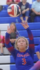 Cooper setter Pearce Bjorlie sets the ball for a teammate during Game 1 against Aledo. Aledo beat the Lady Cougars 25-20, 25-10, 25-21 in the District 4-5A volleyball match Tuesday, Oct. 2, 2018, at Cougar Gym.