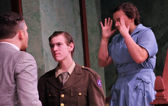 """Freda Benson (Cambria Jaramillo) reacts to her husband (Blair Stewart)  Sam's outburst that the young man (Hunter Reynolds) in uniform between them is not their son returned from war in this rehearsal scene from """"The Death and Life of Larry Benson,"""" the season-opening production at McMurry University that opens Thursday."""