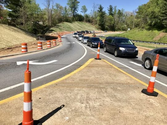 Work to improve the interchange at I-40 at Hendersonville Road has been delayed for new traffic signals to come in, but work should be completed this fall, on schedule.