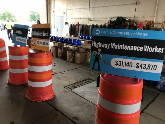 Signs posted around the Broome County Highway Department facility during the Construction and Technology Career day Wednesday displayed the wages of various trade jobs.